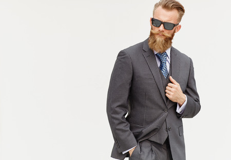 men shirt: Handsom beard male model in suit and sunglasses against white background