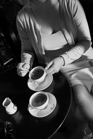 shop for: Adult woman sitting in coffee shop for drinking coffee
