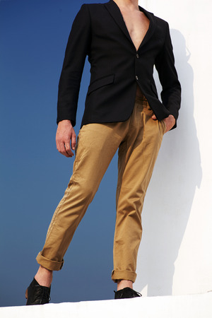 adult  male: Male fashion model in conceptuale fashion style opposit white and blue
