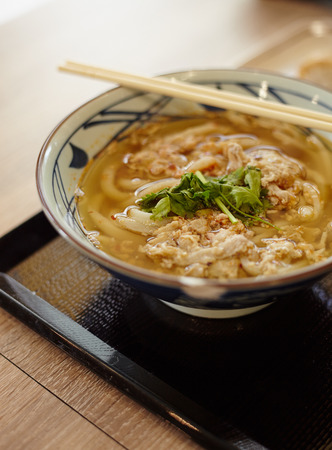 japanes: Traditional japanes noodle with beef, udon on the served table with chopsticks Stock Photo
