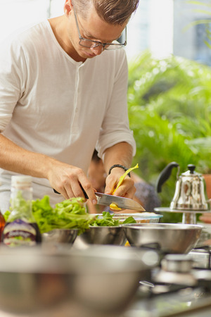 handsom: Man making food in home and restourant kitchen