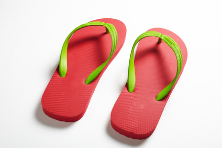 footware: Red slippers in highg resoluttion wittth shadows on the white background