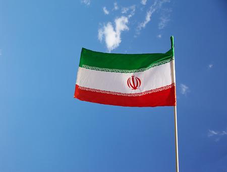 iranian: Close up shot iranian national flag against blue sky Stock Photo
