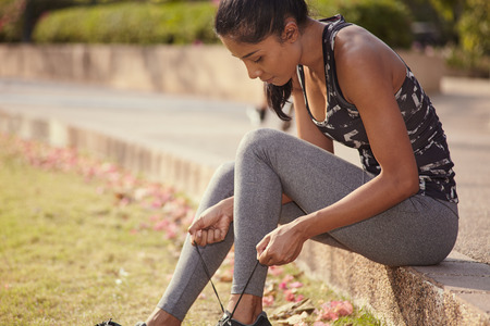 Asian fitness model relaxing in the park after running