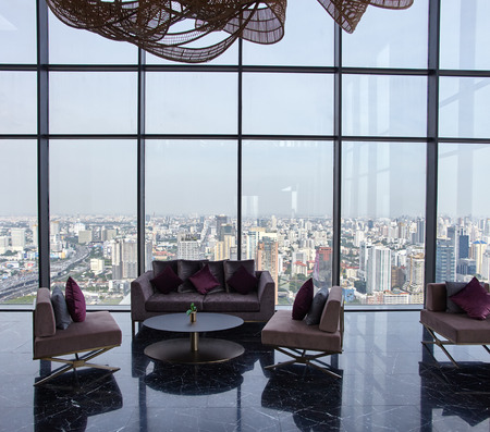penthouse: Hall with chair and table with panoramic window and city skyline