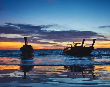 aonang: Sunset view from Rilay beach, Thailand to the clouds, and boats silhouette