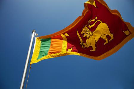 Close up Sri Lanka flag against blue sky