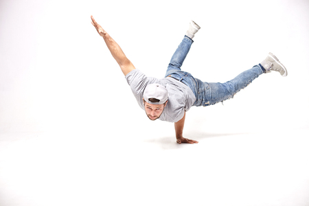 Conterporary hip-hop music dancers in movement in the studio Stock Photo