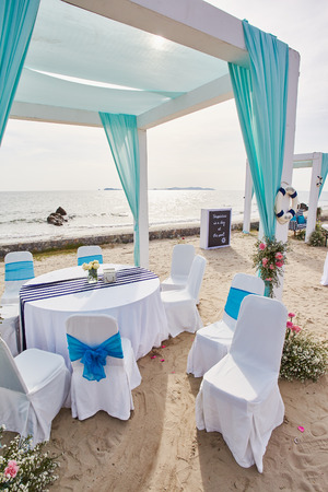 Merriage engagement arch and pavilion placed at the beach for ceremony 스톡 콘텐츠