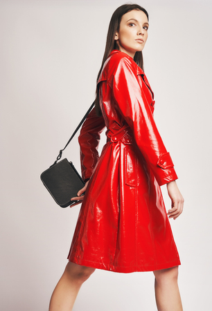 Fashion model at the studio with editorial catalog style clothe  in red leather jacket