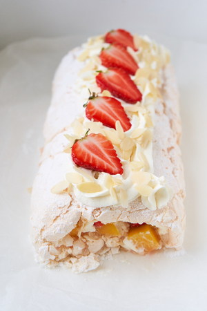 Home made sweet strawberry merengue roll on the white