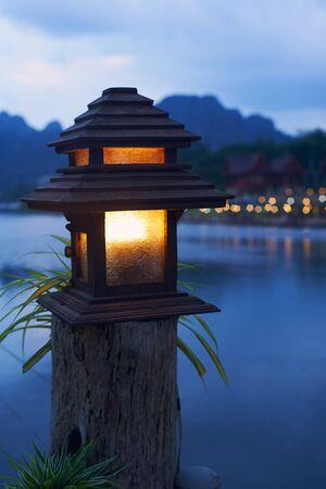 Night sceen with blue dark and lantern with yellow light 版權商用圖片 - 128225155
