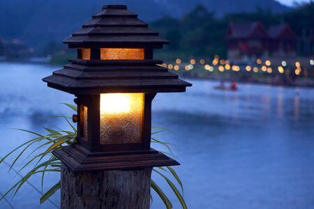 Night sceen with blue dark and lantern with yellow light 版權商用圖片 - 128225179