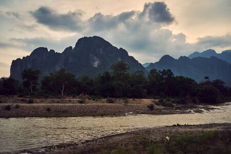 Laos, Van Vieng city landscape with river and mountains 版權商用圖片 - 128225989