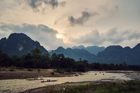 Laos, Van Vieng city landscape with river and mountains and boat, kayak on the water 版權商用圖片