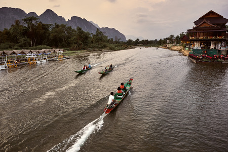 Laos, Van Vieng city landscape with river and mountains and boat, kayak on the water 新聞圖片