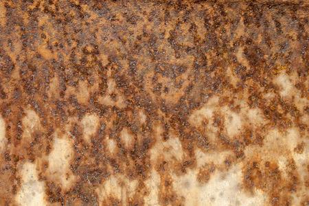 weatherworn: Rusty metal surface.