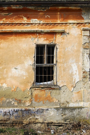 Old wooden window with lattice on the wall of an old house in Hajducica, Banat Stock Photo