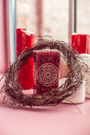 candes: Red and white candes with wreath ovwer pink table