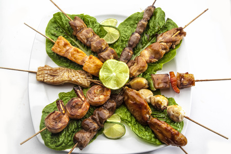gril: Barbeque set with green fresh salad and lime on white plate Stock Photo