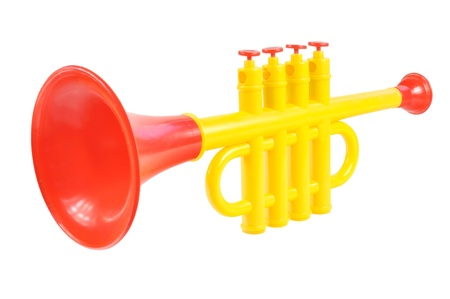 Children trumpet made of colored plastic against white background Stock Photo