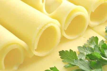Cheese rolled in tubes and parsley Stock Photo