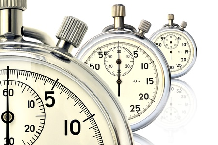 Three old mechanical stopwatch against white background