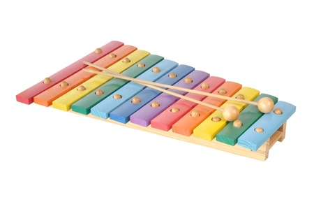 Rainbow colored wooden toy xylophone against white background Stock Photo