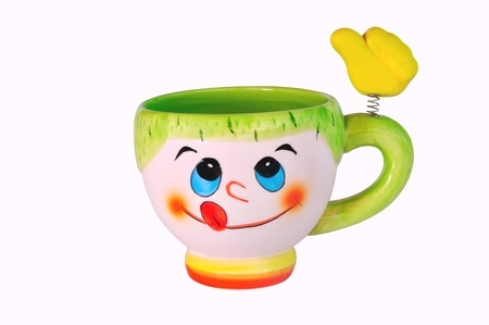 Color ceramic cup with a hand on a spring Stock Photo