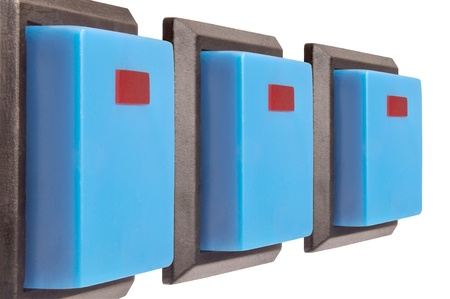 Three electrical switch with blue buttons against white background