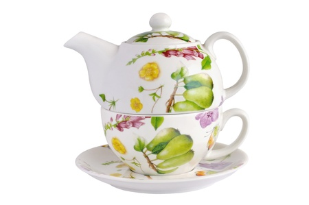 Teapot, cup and saucer against white background Stock Photo