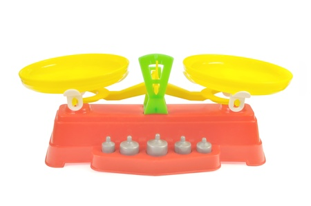 Toy balance with weights of colored plastic against white background Stock Photo - 10312494