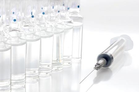 medical injection: Single use syringe against white background Stock Photo