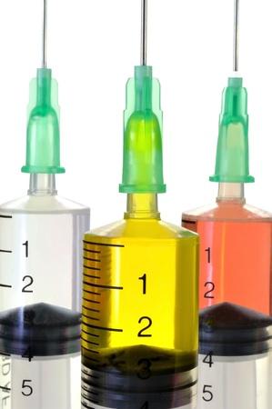 Three disposable syringe against white background