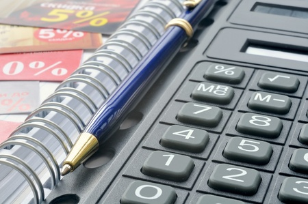 Pocket calculator and blue pen in notebook Stock Photo - 10314792