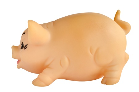 Pig figurine made of rubber against white background