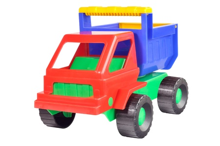 Toy dump truck out of colored plastic against white background