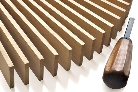 Wooden planks and an old chisel against white background Stock Photo