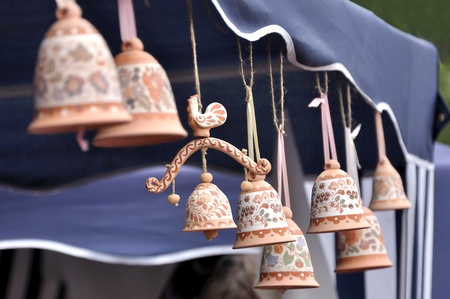 loamy: Clay souvenir bells decorated with paintings of Russian folk Stock Photo