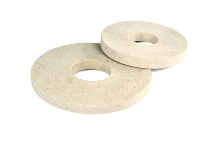 Two abrasive wheels on a white background