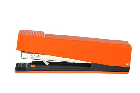 Stapler with orange plastic overlays on white background