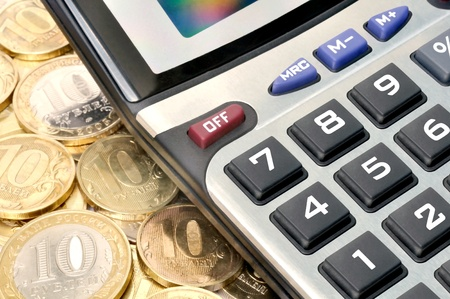 Pocket calculator and a lot of Russian metal coins Stock Photo - 12229381