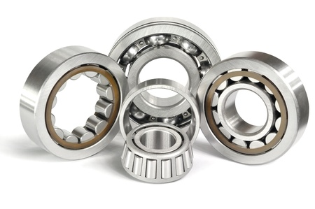 steel balls: Four roller and ball bearings on a white background