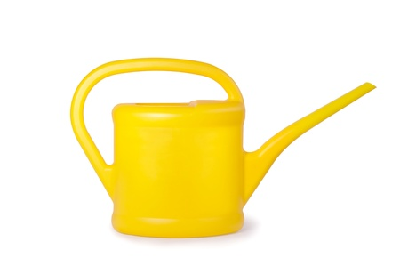 Yellow plastic watering can on a white background