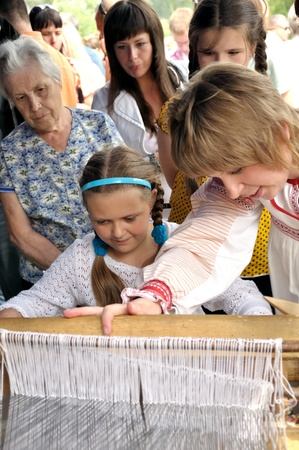 KRAPIVNA, RUSSIA -18 JUNE  unidentified women and children in ancient loom on the traditional annual