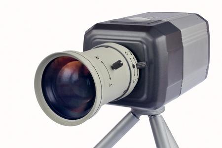 Digital video camera on a tripod on a white background Stock Photo