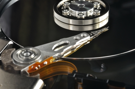 Close up of opened hard disk drive, data saving concept