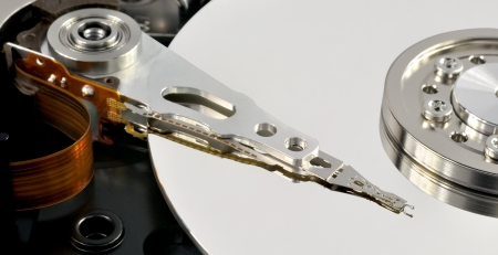 Close up of opened hard disk drive, data saving concept photo