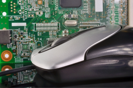 Computer mouse on the background of electronic board Stock Photo