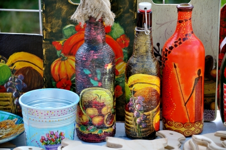 Three painted bottle, bucket and other souvenirs of folk art Stock Photo